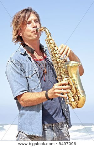 Professional saxophone player at the beach