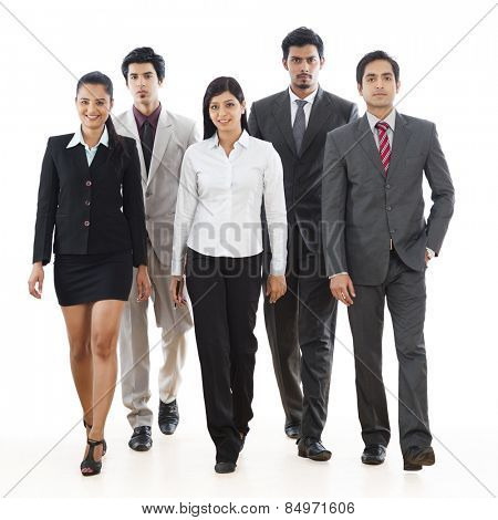 Portrait of five business executives walking
