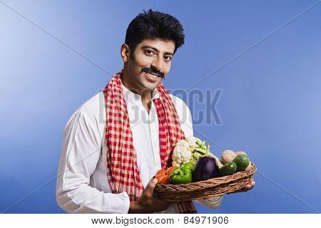 Portrait of a man carrying basket of vegetables