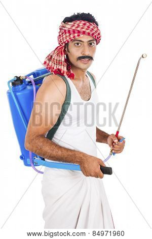 Portrait of a farmer carrying crop sprayer