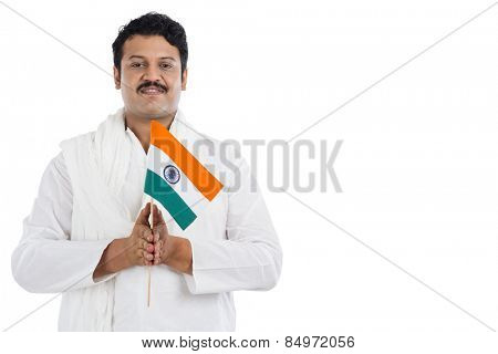 Portrait of a man holding national flag of India