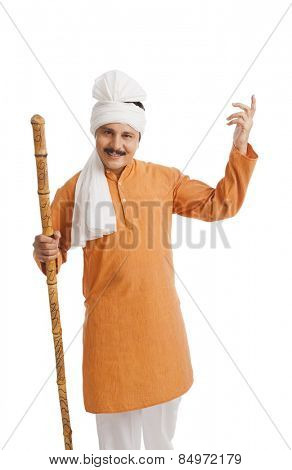 Portrait of a man holding wooden staff and gesturing