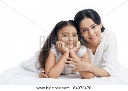 Portrait of a woman smiling with her daughter