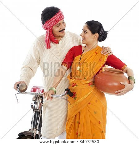 Close-up of a couple with bicycle