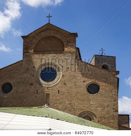 Low angle view of a church, Collegiate Church of San Gimignano, Piazza Del Duomo, San Gimignano, Siena, Siena Province, Tuscany, Italy
