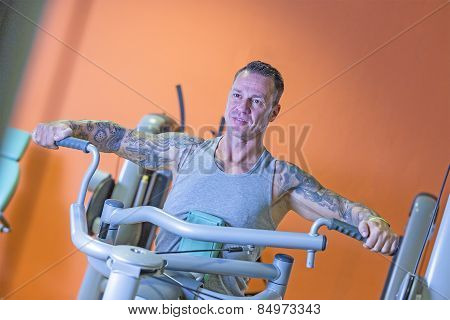 Young Man Making Seated Rowing - Workout Routine .