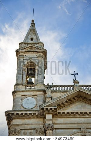 Low angle view of bell tower of a cathedral, Alberobello, Bari, Puglia, Italy