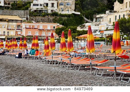 Beach umbrellas and lounge chairs on the beach, Positano, Amalfi Coast, Campania, Italy