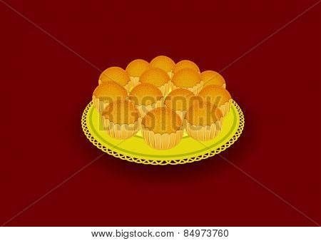 Diwali sweet Laddu in tray isolated on brown background