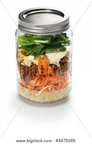 vegetable salad in glass jar isolated on white background
