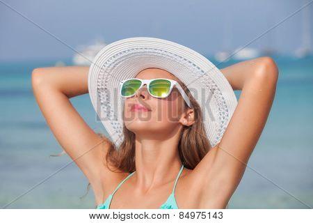 woman with sunglasses sunbathing