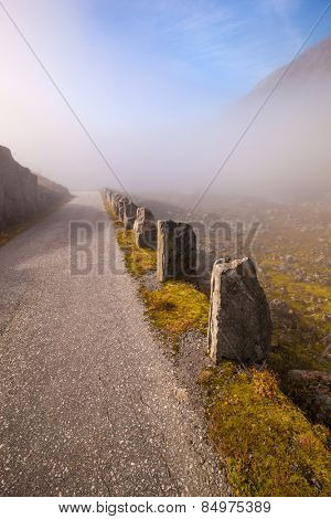 Foggy and sunny road in Norway Gamle Strynefjellsvegen