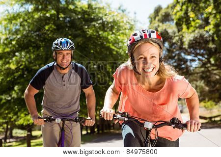 Happy couple on a bike ride on a sunny day