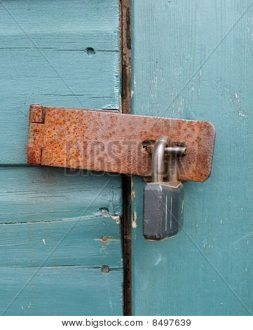 Rusty Padlock on Wood