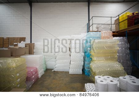 Close up of plastic packaging and paper roll in a large warehouse