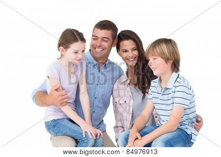 Happy children sitting on parents laps over white background