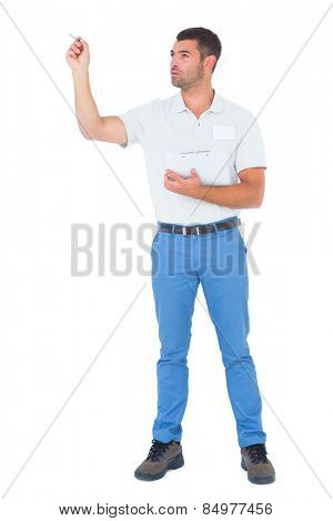 Full length of male supervisor with clipboard inspecting on white background