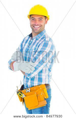 Portrait of confident manual worker standing on white background