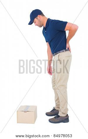 Full length side view of delivery man suffering from backache on white background