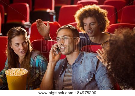 Annoying man on the phone during movie at the cinema