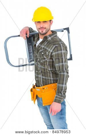 Smiling manual worker carrying step ladder on white background