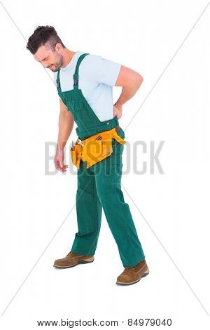 Carpenter suffering from backache on white background