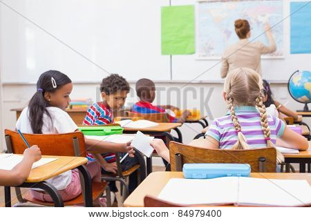 Naughty pupil in class at the elementary school