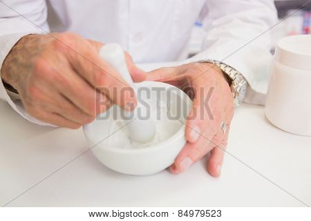 Close up of pharmacist mixing medicine in the pharmacy