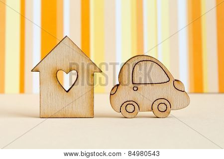 Wooden House With Hole In The Form Of Heart With Car Icon On Orange Striped Background