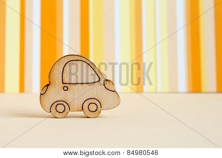 Wooden Car Icon On Orange Striped Background