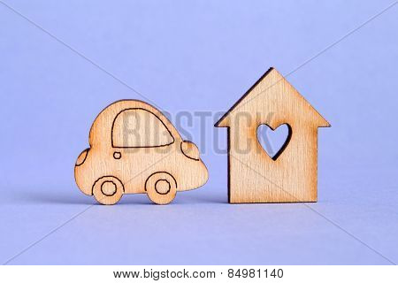 Wooden House With Hole In The Form Of Heart With Car Icon On Purple Background