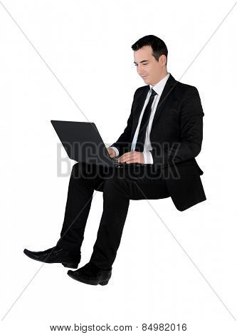 Isolated business man using computer