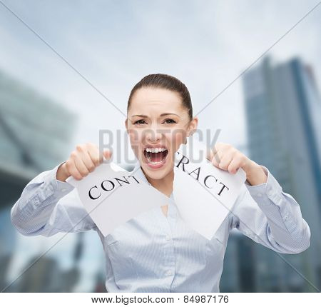 business, documents, people, legal and real estate concept - serious businesswoman tearing contract outdoors