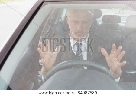 Nervous man sitting at the wheel in his car