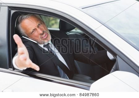 Businessman experiencing road rage in his car