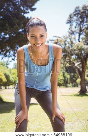 Fit woman taking a break in the park on a sunny day