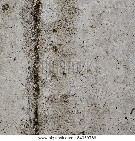 Old concrete wall with a crack in it