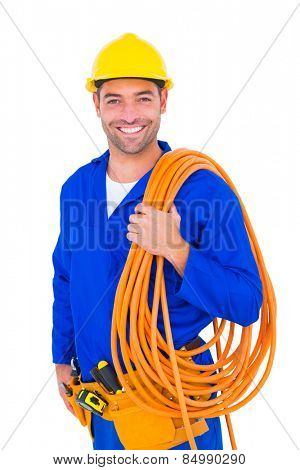 Portrait of smiling handyman with rolled wire standing isolated on white background