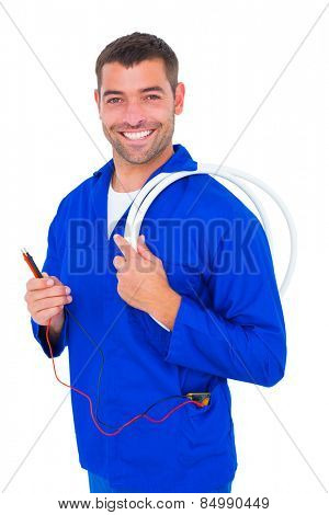 Portrait of smiling electrician with wire roll and multimeter on white background