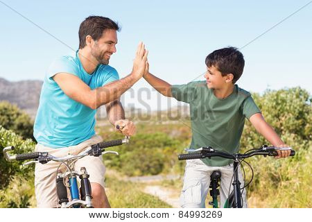 Father and son on a bike ride on a sunny day
