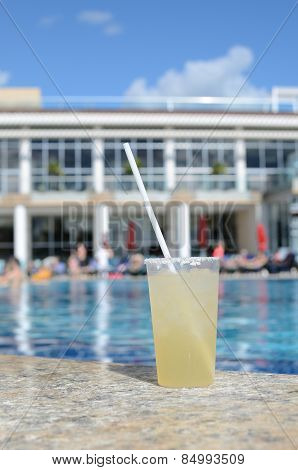 A Glass With A Cocktail Near The Swimming  Pool