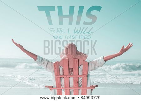 Woman relaxing in deck chair by the sea against this year i will be inspired