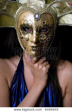 Portrait Of Young Woman In A Venetian Mask