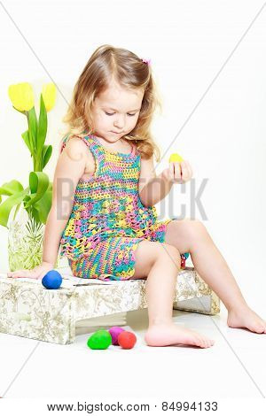 Blonde Curly Girl With Easter Eggs