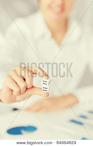 business, office, winning, gambling concept - woman hands with gambling dices showing double six
