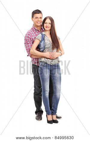 Full length portrait of a cheerful young couple posing isolated on white background