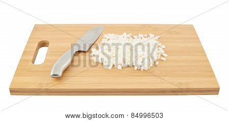 Cut in pieces onion over cutting board