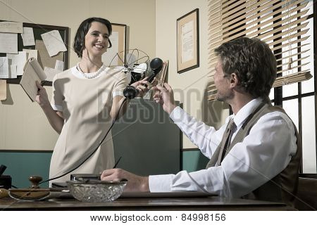 Young Vintage Secretary Holding Phone Receiver