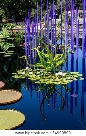 Green And Blue Glass In Pond