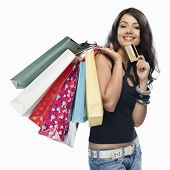 pic of indian money  - Portrait of a young woman holding shopping bags and a credit card - JPG